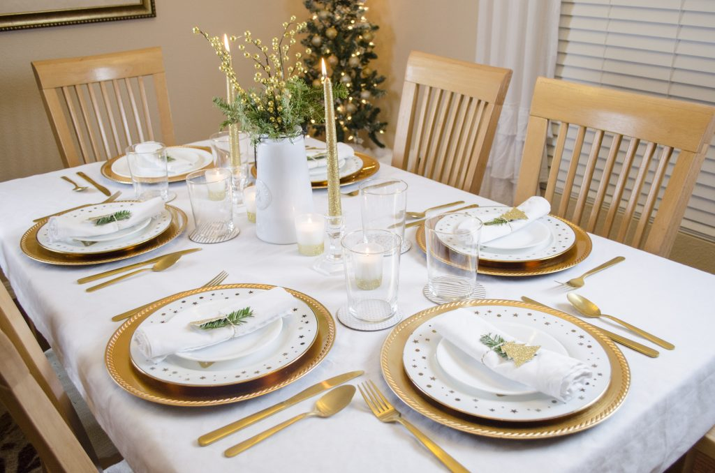Christmas table setting in white and gold.